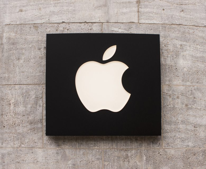 Berlin, Germany - Mai 30, 2014: Apple Store logo in Berlin Kurfürstendamm. Apple Inc. is an American multinational corporation headquartered in Cupertino, California, that designs, develops, and sells consumer electronics, computer software, and personal