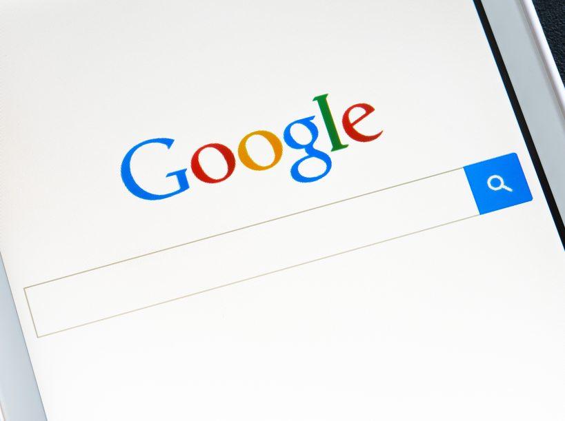 ZAPORIZHZHYA, UKRAINE - NOVEMBER 07, 2014: White Smart Phone with Google Search on Screen