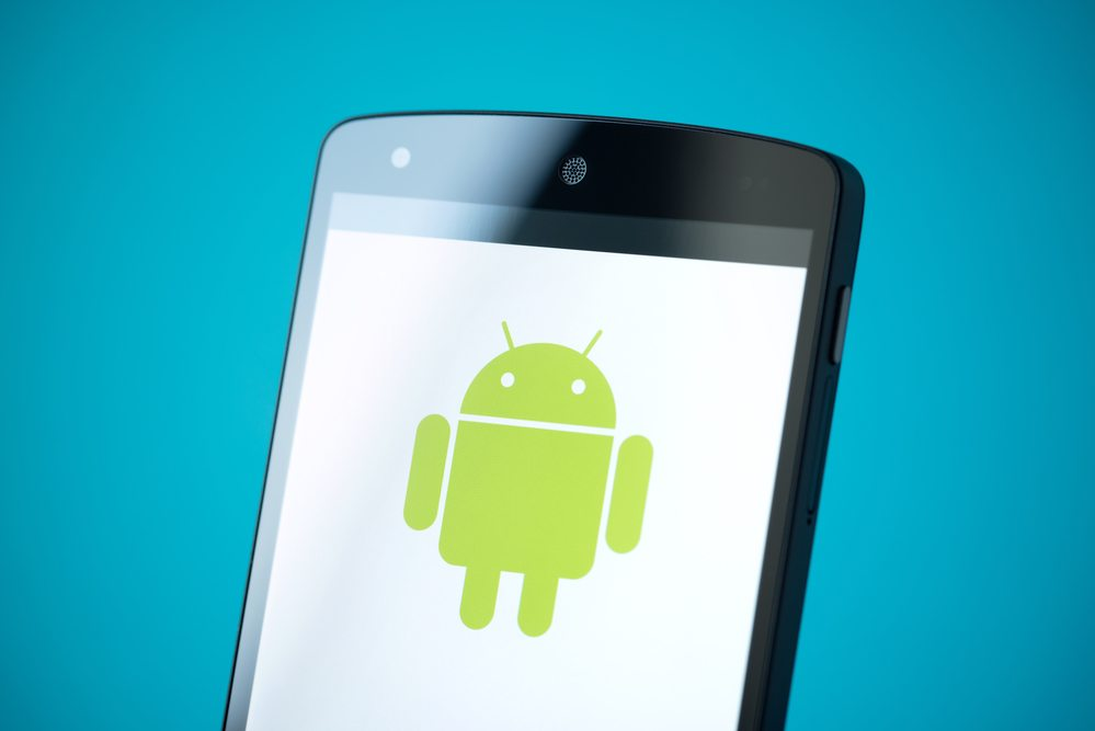 Kiev, Ukraine - September 24, 2014: Close-up shot of brand new Google Nexus 5, powered by Android 4.4 version, with Android logotype on a screen.