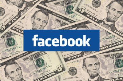 Johor, Malaysia - Jan 1, 2014: Photo of Facebook icon and cash money. Marketers are starting to embrace the social network as a place to do business.  Jan 1, 2014 in Johor, Malaysia.