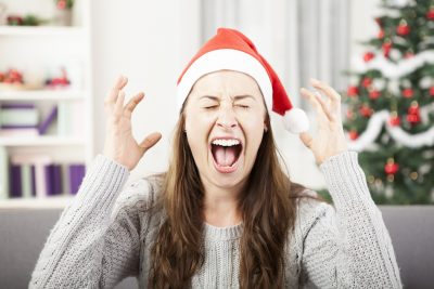 young girl screams because of bad christmas stress